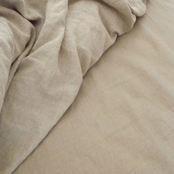 Smooth Linen Sheets - I love linen sheets because they always look a bit wrinkled and carefree, the way I want to feel in the summer. Plus, they're divine to sleep on.