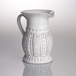 Charlot Lace Design Pitcher - 1 qt - Ceramic serveware offers a visual weight on your table that provides substance and character to the look, and the charming shapes and textures used to create the Charlot Lace Design Pitcher also convey a marked appreciation for handsome traditional craftsmanship.  Elegant but faintly quirky, the pitcher rests on a textured foot and presents beautiful detailing over its lower half.