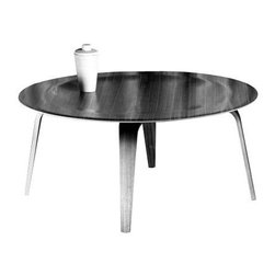Eames Molded Plywood Coffee Table - Herman Miller - This simple coffee table with the bent-plywood legs and a large circular tray-like top is a modern icon that can sidle up to any sofa with ease.