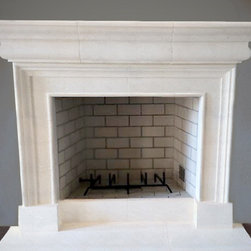 The Columbia Fireplace - This limestone fireplace can be ordered and customized with DeSantana Stone Co. Our team of design professionals is available to answer any questions you may have at: (828) 681-5111.