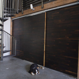 Wine Oak Barn Doors - These doors are custom made from the wood that is used in the aging process of wine. How can you have a better source than that? Besides being a great reuse of materials, these doors are industrial yet add the perfect amount of life and warmth to any space. Since they come from reclaimed material, no two doors are the same.