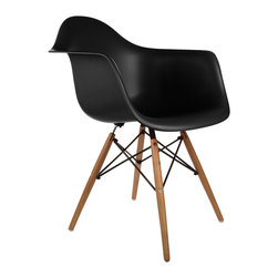 """Montmartre Arm Chair in Black - Some designs were ahead of their time. Considered the chair of tomorrow both for its design and its innovative single-mold manufacturing process, the Montmarte Arm Chair is inspired by one of the most iconic mid-century furniture designs. Created in the spirit of economy and affordability, its unique shape was designed to spread the sitter's weight and pressure evenly. The deep seat and waterfall edge provide additional comfort as the design shapes itself around the body's curves, while its ashwood dowel legs add a classic touch. If you've done away with formality in your home, the Montmarte Arm Chair is that one piece of furniture that exemplifies the """"less is more"""" ethos. It's the ultimate seat that goes well in a variety of different settings: as a home office chair, an entryway slipper seat, or a statement piece in the living room."""