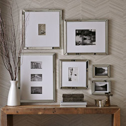 Mirror Gallery Frames - Mirrored gallery frames add a bit of shine to any collection of photos on a wall.