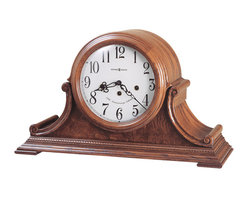 Howard Miller - Howard Miller - Hadley Mantel Clock - Adorn your cabinet, decorative stools, or mantel space with this stellar Harlequin Anniversary Edition Clock featuring Oak Yorkshire finish on exquisite hardwoods, lovely lambswool dial, black serpentine hour and minute hands among other beautiful accents. * This 78th Anniversary Edition tambour style mantel clock is rich in details. . A beaded molding surrounds the base, accenting the carved side scrolls and olive ash burl veneered front panel. . Beneath a convex glass crystal, the lambswool dial offers black Arabic numerals, black serpentine hour and minute hands, and a special 78th Anniversary inscription (inscribed through 2004) . Key-wound, Westminster chime movement with chime silence option and durable bronze bushings. . Finished in Oak Yorkshire on select hardwoods and veneers. . 11-1/4in (29 cm) H x 19in (48 cm) W x 6-3/4in (17 cm) D