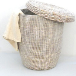 Woven Hamper - Every kid has dirty clothes and needs a nice looking place to put them. I like that this basket has a lid and can hide the mess that would go inside!