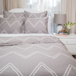 The Cora Gray - Redecorate with this chevron duvet cover to instantly transform your bedroom. With beautifully illustrated dots lined perfectly to graphically create a large scale zigzag pattern, the Cora Gray Chevron bedding set is our freshest and most sophisticated take on the chevron pattern.
