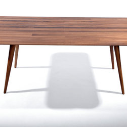 Se_Go Dining Table - An elegant dining table with legs that create a unique sculptural profile. The Se_Go Dining Table is a simple yet artistic expression of reinventing classic designs into contemporary masterpieces. Made  in sustainably forested European walnut (available also in cherry, maple, oak, ash and elm) and finished with eco-friendly Danish oil.  Available in different sizes.