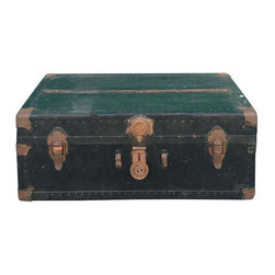 Used Antique Black Trunk - This large vintage trunk is the perfect conversation piece. Provides excellent storage and looks great stacked with other vintage items as well. Would also work well as a low coffee table. Trunk is nicely aged with gorgeous metal accents and stickers that show some history. Color is a neutral, distressed, black finish.This trunk does not lock and the latch does not catch.    Note from seller: Low priced curbside delivery is also available to the NJ/NYC area for an additional fee (depending on where you are located). To find out more please contact support@chairish.com.  If you opt for this service, we'll ask you to choose local pick up and we can coordinate the delivery separately.