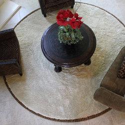 beige circle area rug with animal print -