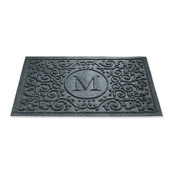 Frontgate - WATER & DIRT SHIELD ™ Mandalay Monogram Door Mat - Door mat will not fade, deteriorate, mildew, or succumb to heavy foot traffic. Slip-resistant recycled tire backing. Suitable for all floor types. Rinses clean with a hose. Note: Do not place on wet floors. The WATER & DIRT SHIELD ™ Mandalay Door Mat holds dirt and a gallon of liquid, even when it's picked up. Thick polypropylene fibers whisk mud from your shoes and pet's feet to keep your entryway clean.. . . . . Made in USA.