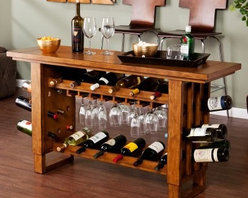 Southern Enterprises Syrah Riddling Wine Console Table - Show off your exquisite taste in wine and furniture with the Syrah Riddling Wine Console Table by Southern Enterprises. This all encompasing furniture piece holds up to 30 wine bottles. Interior shelves hold 12 bottles each leg panel holds 9 bottles. Top interior shelf has a built in stemware rack to keep your wine glasses handy. This is a great entertainment piece for wine lovers. Acts not only as a wine table useful as a kitchen island breakfast table or server. Thick wood is solid poplar with birch veneer with subtle black distressing for a vibrant rich look. Overall dimensions: 54W x 17.25D x 30.25H inches. Some assembly required. Additional dimensons: Top shelf: 10.5W x 9.75D x 3H inches. Bottom shelf: 10.5W x 9.75D x 13.5H inches. Height Under Bottom Shelf: 5.25 inches. Height under Counter Overhang: 27.75 inches About SEI (Southern Enterprises Inc.)This item is manufactured by Southern Enterprises or SEI. Southern Enterprises is a wholesale furniture accessory import company based in Dallas Texas. Founded in 1976 SEI offers innovative designs exceptional customer service and fast shipping from its main Dallas location. It provides quality products ranging from dinettes to home office and more. SEI is constantly evolving processes to ensure that you receive top-quality furniture with easy-to-follow instruction sheets. SEI stands behind its products and service with utmost confidence.