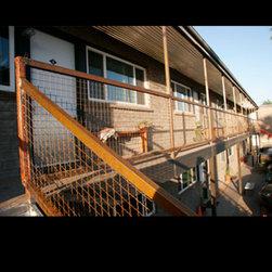 Fencing - Woven steel mesh balcony fence. Daniel Moore