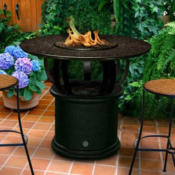 California Outdoor Concepts Del Mar Round Bar Height Fire Pit Table - The California Outdoor Concepts Del Mar Round Bar Height Fire Pit Table is a cozy spot where you and a few friends can indulge in cocktails and conversation. This made-to-order fire pit table features a streamlined design with curved metal base that rises to meet a round granite surface placed at the perfect bar height for your outdoor lounge. Tucked away within the smooth aluminum underbelly is a 20 lb. liquid propane tank (sold separately) and 40 000 BTU stainless steel burner that fires a dazzling low-level flame to provide your next get-together with warmth and lovely ambient lighting. For a finishing touch customize your table with either realistic gas logs and lava rocks that cover the burner or your choice of colorful fire glass. Runs on propane and/or natural gas conversion kit for natural gas is included. About California Outdoor ConceptsCalifornia Outdoor Concepts builds their fire pits and accessories exactly where it would seem - in the sunny climate of idyllic California. By living the lifestyle they sell this small company is able to develop some of the most sophisticated beautiful and practical designs for outdoor socializing. There are no assembly lines at the COC production facility - each piece is handmade and checked for perfection. When you're ready to heat things up in your backyard trust in the true California way.