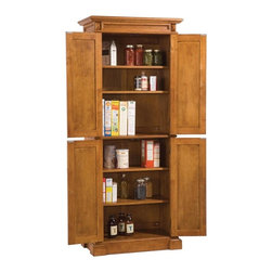 HomeStyles - Pantry Storage Cabinet - Diamond shaped carving details on top. Four doors open to ...
