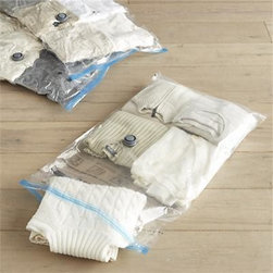 Set of 3 Vacuum Packs - For the most compact clothing and linen storage imaginable, view-through storage bags with easy glider seals have a vacuum hose fixture to remove excess air (see additional photos). Reusable, waterproof bags also protect clothing from dust and pests.