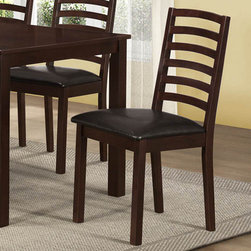 Monarch - Walnut/Brown Leather-Look 36in.H Side Chair - Set of 2 - These sturdy walnut-toned wood side chairs compliment the style of the dining table with their slightly flared legs and dark brown leather-look cushion seats. The bent ladder design of the chair backs accentuates and completes the clean and simple look of the dining set.