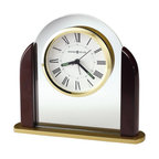 Howard Miller - Howard Miller Derrick Table Clock - Howard Miller - Mantel / Table Clocks - 645602 - This attractive table clock has a pleasant contemporary character and will have a radiant quality on your mantel or table top. Distinguished by its rosewood side columns, glass panel and floating dial with polished brass bezel, the Derrick has an effortless charm to it. Quartz alarm movement with a separate alarm hand completes the appeal of the Derrick Table Clock.