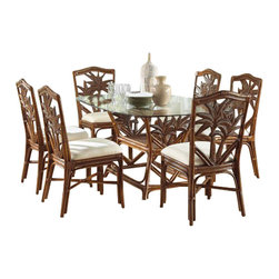 Hospitality Rattan - Indoor 7 PC Rattan & Wicker Dining Set in TC Antique Finish (Skyfall-Ocean) - Fabric: Skyfall-Ocean. The seven-piece Cancun Palm dining set sets a tone for relaxed family meals and entertaining. Six side chairs feature cane framing with frond-themed back insets. A matching glass top rectangular table incorporates a center woven display shelf. Includes: 1 Table - 6 Side chairs. Made of Rattan Poles & Woven Wicker. Sideboard and Mirror not included. Finished in TC Antique Color. Fully assembled. Constructed of commercial quality rattan poles. Herringbone wicker weave. Glass top is a 42 in. x 62 in. Surfboard with beveled edge. Side chair: 20 in. W x 23 in. L x 38 in. H (13 lbs.). Table: 62 in. W x 22 in. L x 30 in. H (87 lbs.)This Cancun Palm dining collection is one of our exclusive and largest collections of fine rattan and herringbone wicker weaving. That has a fiber palm tree castings design. The woven leather bindings used throughout Cancun Palm ensures its durability and quality for many years of use. It enhances the tropical look in any dining room. The selection of two finishes help compliment any room decor.