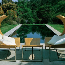 Emu Alveo Chaise Longue with Footrest - This chair and footrest has an elegant curve and hand made wicker materials that make it beautiful and unique. I love the contemporary feel the design adds.