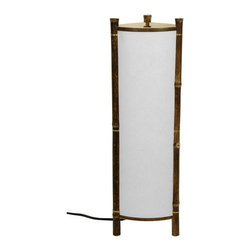 Oriental Furniture - Kamakura Japanese Bamboo Table Lamp - Japanese style bamboo and rice paper table lamp. White paper shade allows for a soft, ambient glow while still providing adequate lighting on a desk, end table, or console. Dark natural bamboo frame consists of three poles and a band around the top and bottom, open for easy access to the light bulb. Natural, simplistic design brings a practical touch of the Orient to any room, from rustic to traditional interior decor. Constructed to fit standard American light bulbs and electrical outlets.