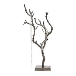 Little Birch Jewelry Stand - You can't have Christmas without a tree, but who says it has to be an enormous green plastic model? Repurpose this elegant jewelry stand into a tabletop tree for small spaces. (Bonus: you'll need fewer decorations.)