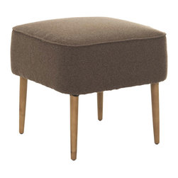 Mid-Century Stool in Brown - This petite mid-century stool has natural-finished spindle legs that speak a mid-century modern design language. Versatile enough to be used as extra seating or as a footstool, the furniture piece has a compact form that can easily tuck in under a console table.