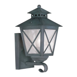 "Livex Lighting - Livex Lighting 2670 Montgomery Large Outdoor Wall Sconce - Livex Lighting 2670 Montgomery One Light Outdoor Wall SconceFeaturing a prominent workman style design, the Montgomery single light bottom mount outdoor wall sconce features a simple rustic kerosene lamp design with a perforated chimney, four sided roof, and clear seedy glass with ""x"" shaped guards. This arts and crafts style light will enhance the look of any outdoor decor.Livex Lighting 2670 Features:"