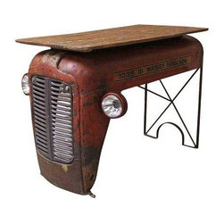Pre-owned Upcycled Vintage Tractor Writing Table - Moo-ve on over! This abandoned vintage tractor was rescued from an empty field and magnificently repurposed into a writing table desk with a reclaimed wood top, giving it a second and useful long life. Curated by an out-of-the-box thinker and creative type who envisions masterpieces when others only see trash. This special and unique design is for the discerning individual who is not into the mass-produced.