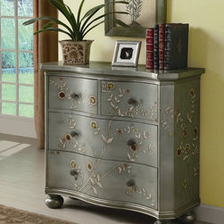 Curved Cabinet in Iridescent Blue - This stunning Curved Cabinet in Iridescent Blue will be a nice addition to your traditionally or transitionally decored room. It features four sizable storage drawers with an unique pattern and color. Finished in an antique iridescent Blue, this hand-painted cabinet with four drawers features curved drawer fronts, floral knobs and stylish ball feet give it a contemporary, sophisticated feel. With so much personality and style, this chic curved accent cabinet is sure to make an attractive addition in your home.