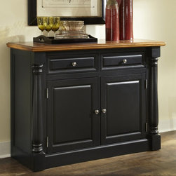 Home Styles - Home Styles Monarch Dining Buffet - Black & Oak - 5008-61 - Shop for Buffets and Side Boards from Hayneedle.com! Add stylish storage to your dining area with the Home Styles Monarch Dining Buffet - Black & Oak. This spacious and versatile buffet is crafted of hardwood solids and engineered wood with a black-finished base. The top - perfect for serving appetizers and drinks - features a multi-step distressed oak finish. Two drawers open to reveal storage options for cutlery utensils and other items. The drawers feature felt-lined bottoms and dividers. Behind the two-door cabinet are adjustable shelves for your dishes serving bowls glasses and other dining necessities. A variety of design elements lend this buffet an elegant traditional style including picture frame moldings solid wood pilasters with intricate carved detail crown moldings and brushed nickel hardware. About Home StylesHome Styles is a manufacturer and distributor of RTA (ready to assemble) furniture perfectly suited to today's lifestyles. Blending attractive design with modern functionality their furniture collections span many styles from timeless traditional to cutting-edge contemporary. The great difference between Home Styles and many other RTA furniture manufacturers is that Home Styles pieces feature hardwood construction and quality hardware that stand up to years of use. When shopping for convenient durable items for the home look to Home Styles. You'll appreciate the value.