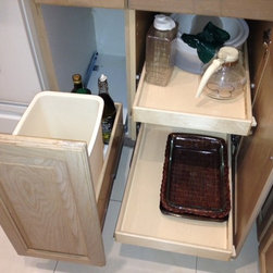 Kitchen Pull Out Shelves and Pull Out Trash Bin - Convert any existing cabinet into a pull out trash bin, even if your current cabinet is hinged.  Our expert installation teams can convert a hinged door into a pull out trash bin, using your existing door to keep your kitchen's original appearance.