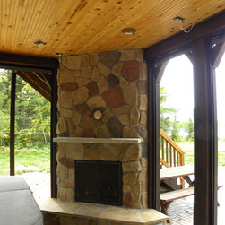 Fireplace-Mth2 - Outdoor fireplace under screen porch. Roll up screen system around post and beams