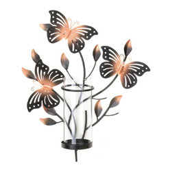 """n/a - Bouncy Butterfly Wall Sconce - Three beautiful butterflies are awaiting candlelight to help them shine brightly!  This charming wall sconce features a tall, clear glass candle cup and platform ready for the candle of your choice.  When lit, the metal cutout butterflies that are fluttering through budding leaves will bring warmth and charm to your room.  Candle not included.  Glass holder 2.25"""" diameter x 7"""" high."""