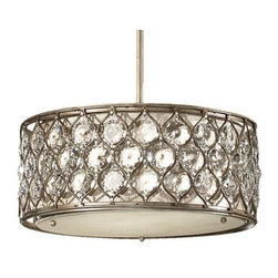 Feiss - Lucia Drum Pendant by Feiss - The formal arrangement of the numerous crystals in the Murray Feiss Lucia Drum Pendant does nothing to diminish their multi-faceted sparkle. Set within a delicate steel net that overlays the drum-shaped Beige fabric shade, the crystals' glimmer is enhanced by the frame's lustrous Burnished Silver finish. A fixture of glittering glamour ideal in a dining room or entryway.