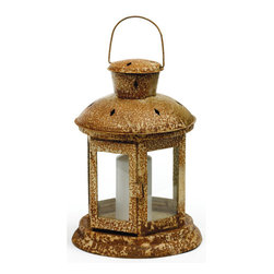 Dune Lantern - Light up your room with this Dune Lantern lamp shade. It is constructed of iron with heavy glass. A simple candle lantern with plain glass covering provides the room with ample illumination.