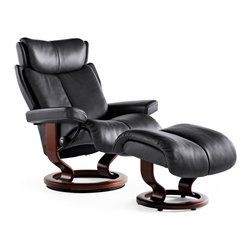 Stressless Magic Chairs - This chair, the Stressless Magic Recliner, earns its name from its legendary comfort and 10 Year Warranty. If you are looking for modern, without going overboard, you have found the perfect seat. Rock Paloma Leather shown with Walnut Stained Wood.