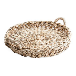 Made Goods - Piper Large Round Tray - Whether you use it for serving or just as an elegant accent piece, this simple tray is a stunning addition to your decor. The loosely weaved banana bark will bring earthy texture to your entertaining.