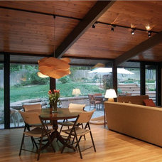 Modern Dining Room by Distinctive Architecture