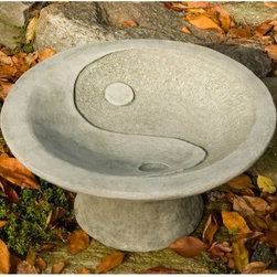 Campania International Yin Yang Pedestal Cast Stone Bird Bath - About Campania InternationalEstablished in 1984, Campania International's reputation has been built on quality original products and service. Originally selling terra cotta planters, Campania soon began to research and develop the design and manufacture of cast stone garden planters and ornaments. Campania is also an importer and wholesaler of garden products, including polyethylene, terra cotta, glazed pottery, cast iron, and fiberglass planters as well as classic garden structures, fountains, and cast resin statuary.Campania Cast Stone: The ProcessThe creation of Campania's cast stone pieces begins and ends by hand. From the creation of an original design, making of a mold, pouring the cast stone, application of the patina to the final packing of an order, the process is both technical and artistic. As many as 30 pairs of hands are involved in the creation of each Campania piece in a labor intensive 15 step process.The process begins either with the creation of an original copyrighted design by Campania's artisans or an antique original. Antique originals will often require some restoration work, which is also done in-house by expert craftsmen. Campania's mold making department will then begin a multi-step process to create a production mold which will properly replicate the detail and texture of the original piece. Depending on its size and complexity, a mold can take as long as three months to complete. Campania creates in excess of 700 molds per year.After a mold is completed, it is moved to the production area where a team individually hand pours the liquid cast stone mixture into the mold and employs special techniques to remove air bubbles. Campania carefully monitors the PSI of every piece. PSI (pounds per square inch) measures the strength of every piece to ensure durability. The PSI of Campania pieces is currently engineered at approximately 7500 for optimum strength. Each piece is air-dried and then de-molded by hand. After an internal quality check, pieces are sent to a finishing department where seams are ground and any air holes caused by the pouring process are filled and smoothed. Pieces are then placed on a pallet for stocking in the warehouse.All Campania pieces are produced and stocked in natural cast stone. When a customer's order is placed, pieces are pulled and unless a piece is requested in natural cast stone, it is finished in a unique patinas. All patinas are applied by hand in a multi-step process; some patinas require three separate color applications. A finisher's skill in applying the patina and wiping away any excess to highlight detail requires not only technical skill, but also true artistic sensibility. Every Campania piece becomes a unique and original work of garden art as a result.After the patina is dry, the piece is then quality inspected. All pieces of a customer's order are batched and checked for completeness. A two-person packing team will then pack the order by hand into gaylord boxes on pallets. The packing material used is excelsior, a natural wood product that has no chemical additives and may be recycled as display material, repacking customer orders, mulch,or even bedding for animals. This exhaustive process ensures that Campania will remain a popular and beloved choice when it comes to garden decor.Please note this product does not ship to Pennsylvania.
