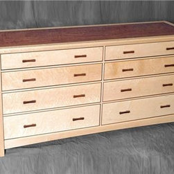 RS Dresser - An elegant dresser that fits well in almost any bedroom setting, this RS dresser is artisan made with lots of woodworking expertise. The legs are solid Eastern Hard Maple along the drawer dividers. The drawers on solid Birdseye Maple framed with 1/8 Rosewood beading. The top and sides are composed of Birdseye Maple, Inlay composed of 1/16 ebony, 3/16 Rosewood, and ebony. The center is figured Bubinga.