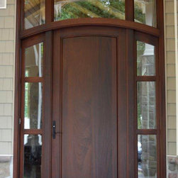 Custom exterior front door - Solid panel mahogany wood front entry door unit features custom three lite sidelites and transom.  Clean and contemporary styling finished in a medium dark brown stain.  Nothing welcomes like wood.