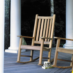 "Kingsley Bate - Charleston Rocking Chair - A combination of ergonomic comfort and solid Teak, our high backed rocker can stay on your porch year round without deterioration. Additional Information: -Includes Charleston Rocker - Ships within 24 hours. -Constructed of solid Teak. -Seat height: 16"". -Overall dimensions: 32""L x 23""W x 42""H. About Kingsley-Bate and Teak British craftsmen of the 18th century discovered what their Eastern counterparts had known for centuries, that teak has qualities unlike any other wood. It's ability to withstand the rigors of adverse climate, yet weather attractively, make it the ideal choice for outdoor furniture. As America's leading manufacturer of teak outdoor furniture, we use only premium quality teak and precise mortise and tenon joinery in the construction of our furniture. Kingsley-Bate also leads the way in the responsible manufacture of its furniture. Kingsley-Bate is the first American company to use Javanese teak in the manufacture of its furniture. Our teak is harvested from carefully controlled plantations, established in Indonesia by the Dutch in the Mid-19th century. Due to the increasing demand for this beautiful hardwood, Kingsley-Bate now uses a select amount of Burmese teak in its productions. Whether Javanese or Burmese, you can be assured that we use only the finest quality teak in our furniture. Manufactured with precise mortise and tenon joinery, the furniture is shipped partially assembled. The factory fully assembles each piece prior to shipment to ensure that reassembly will take a minimum of effort and all pieces will fit together to our precise specifications. Some Kingsley-Bate projects of note include: Disney World, Hyatt Regency, Boston Symphony Orchestra-Tanglewood, Newport Aquarium, Biltmore Estate, Chicago Botanical Gardens, University of California-Berkley, and M.I.T. Limited Warranty Information: With proper use and care, Kingsley-Bate is confident that their products will provide you with years of trouble-free enjoyment. Your furniture comes with a limited warranty against manufacturer's defects. Standard warranty periods for each category of furniture are provided below. Teak Furniture: -5 year warranty for residential applications. -3 year warranty for commercial applications. Stainless Steel Furniture: -3 year warranty for residential or commercial applications. -1 year warranty for sling. Woven Furniture: -3 year warranty for residential or commercial applications. Umbrellas bases: -3 year warranty for residential or commercial applications. -1 year umbrella base warranty for residential or commercial applications (corrosion not covered)."