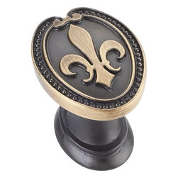 Jeffrey Alexander - 1-5/16 Inch Overall Length Fleur-De-Lis Knob - 1 5/16 inch Overall Length Fleur de lis Knob with decorative beaded trim.  Packaged with one 8/32 inch x 1 inch screw. Finish:Antique Brushed Satin Brass.