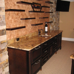 Floating Shelves - Floating shelves on faux finished wall over bar countertop.