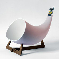 """en&is design - Megaphone - The Megaphone is a hand-crafted """"passive amplifier"""" for iPhones. It expands the music like old-school phonographs did back in the day: with an elegant, sound-amplifying horn. The Megaphone not only increases the tone and volume of music without electricity, but it amplifies the sound of a voice on the line as if the person is standing in the room. Crafted from clay and resting on a wooden stand, the Italian-made Megaphone is available for $500 in white or black and for $800 in hand-painted gold."""
