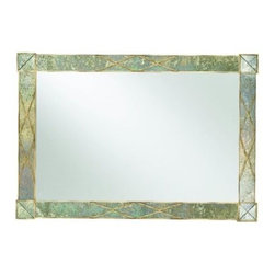 Dune Landscape X Frame Mirror - 58W x 40H in. - Interesting and nuanced with the look of an abalone shell, the Dune Landscape X Frame Mirror brings a feeling of calm and depth to your space. Reflective and serene, this mirror is timeless in style. The X-motif frames the corners and the dune finish shines in the light. Hang this transitional piece in your home and watch the compliments roll in.Not available for sale in, or delivery to, the state of California.About Hooker Furniture CorporationFor 83 years, Hooker Furniture Corporation has produced high-quality, innovative home furnishings that seamlessly combine function and elegance. Today, Hooker is one of the nation's premier manufacturers and importers of furniture and seeks to enrich the lives of customers with beautiful, trouble-free home furnishings. The Martinsville, Virginia, based company specializes in lifestyle driven furnishings like entertainment centers, home office furniture, accent tables, and chairs.Construction of Hooker FurnitureHooker Furniture chooses solid woods and select wood veneers over wood frames to construct their high-quality pieces. By using wood veneer, pieces can be given a decorative look that can't be achieved with the use of solid wood alone. The veneers add beautiful accents of color and design to the pieces, and are placed over engineered wood product for strength. All Hooker wood veneers are made from renewable resources and are located primarily on the flat surfaces of the furniture, such as the case tops and sides.Each Hooker furniture piece is finished using up to 30 different steps, including 13 steps of hand-sanding and accenting. Physical distressing is done by hand. Pieces receive two to three coats of solid lacquer to create extra depth and add durability to the finish. Each case frame is assembled using strong mortise-and-tenon joints, which are then reinforced by mechanical fasteners and glue. On most designs, end panels extend to the floor to add strength and stabili