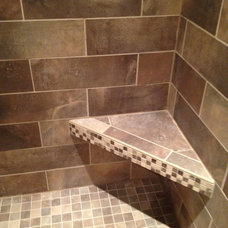 Traditional Tile by Total Quality Home Builders, Inc.