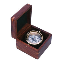 """Gimbaled Boxed Compass with Hand Inlayed Compass Rose - The Boxed Compass with Hand Inlayed Compass Rose is a beautiful reproduction of an antique gimbaled brass compass in a beautifully inlayed hardwood box.  Hand inlaying hardwood is an old time-honored art that requires considerable talent, patience, and precision to create a beautiful one-of-a-kind piece. This hardwood box features a inlayed compass rose made from four different species of beautiful hardwood.  As each compass rose is inlayed into the hardwood box using similar hand tools to those used 200 years ago, each compass is unique and will have slight variations. The 2 5/8"""" dia. compass is fully gimbaled with a solid brass gimbal set.  The gimbaled brass compass is protected by a glass cover.  The corners of the hardwood box have lighter hardwood splines to offer additional strength and support.  The hardwood case is 4 5/8"""" square, 3 5/16""""tall, and the compass weighs 1 pound 5 ounces. This boxed compass makes a beautiful addition to a nautical collection or executive's desk."""
