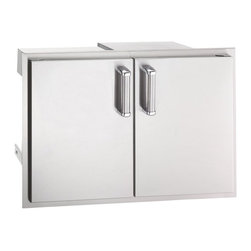 Fire Magic - Fire Magic 43930S-12 Double Door and Double Drawer with Trash Tray - 43930S-12 - Shop for Accessories and Parts from Hayneedle.com! The product specialists at Hayneedle have been extensively trained by the manufacturer of Fire Magic grills. These specialists know the product inside and out top to bottom front to back. They're here to help you with every step of your Fire Magic grill purchasing process. Learn everything you need to know as you customize your grill island with drawers doors pizza ovens and more! Call 866-579-5183 to speak with a product specialist and start building your dream grill island today. Hours: Monday-Friday 9 a.m.-7 p.m. E.T.It makes sense that the Fire Magic 43930S-12 Double Door and Double Drawer with Trash Tray unit has multiple components - altogether they offer multiple storage possibilities for your outdoor kitchen. Crafted with commercial-quality stainless steel this two-door unit opens to two smooth-sliding drawers and a pullout tray ideal for a gas or propane tank or trash bin. Designed to build seamlessly into Fire Magic grill systems the unit boasts foam filled doors for a solid sound and feel double walls ventilation louvers tubular handles radial corners and a secure magnetic closure.About Fire MagicFire Magic understands more about the amazing things that happen when flame and good food meet. For the last 70 years they've set out to create the singularly best way to cook food outdoors using the highest-quality materials innovative design and an absolutely relentless pursuit of perfection. With a complete line of luxury-grade grills burners accessories and built-in grill island components Fire Magic is ready to turn your home into the world's best outdoor kitchen.