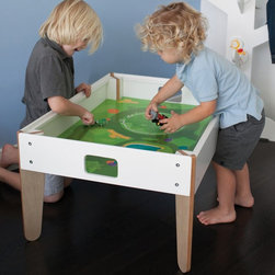 Pkolino - P'kolino Little Modern Activity Table Multicolor - PKFFMATWH - Shop for Childrens Tables from Hayneedle.com! Kids can bring every idea to the table especially when that table's the P'kolino Little Modern Activity Table. This durable wooden child-height table boasts diagonally designed legs and a spacious reversible top that's natural wood on one side chalkboard on the other. Cutout handles on either side make transporting the table from room to room easy and a large open space underneath the table is the perfect spot for a few toy bins or clothing boxes. Assembly required. About P'kolinoPkolino believes that children learn and grow through play so they were puzzled as to why play furniture for kids wasn't fun. This is why they developed a line of stylish yet practical furniture pieces for kids. In 2004 as students in an MBA program the two founders discovered their shared desire to create play furniture that was designed to meet children's needs for play and mental physical and social growth. Pkolino now has an extensive line of products developed to be fun functional and beautiful.